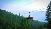 A Kokanee Zipline Guide going down the line.
